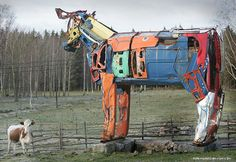 What do you do with a bunch of old cars? You make cows out of them of course!