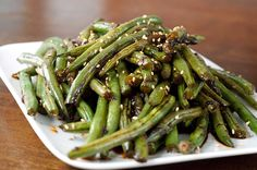 Cactus Club Szechuan Green Beans Recipe Ingredients 2 cups canola oil, plus 1 tablespoon 1 tablespoon minced fresh ginger 1 tablespoon minced garlic cup soy sauce 1 ounce hot chili sau Sous Vide Vegetables, Asian Vegetables, Fruits And Veggies, String Bean Recipes, Green Bean Recipes, Vegetable Recipes, Beans Recipes, Veggie Side Dishes, Vegetable Sides