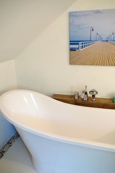 freestanding bathtub, white bathroom