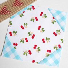 Block 46 - Cherry Snowball. A classic block prettied up with Lori Holt fabrics.