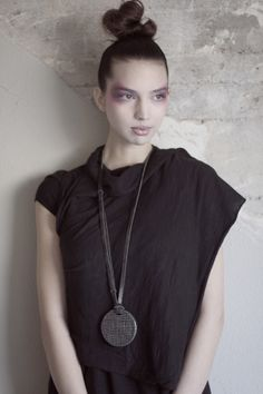 Wood and pressed brass with leather, adjustable necklace