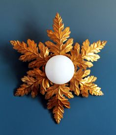 Gilt sunburst lamp: Ceiling lamp, flush mount or wall sconce. Leaves and branches. Mid century vintage 60s.