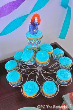 Cupcakes with toy on top - MUCH cheaper than the cakes I'm pinning lol