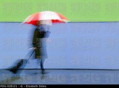 Blurred Traveler With Umbrella