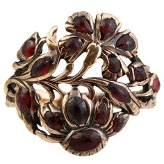 Georgian Garnet Gold Giardinetti Ring | From a unique collection of vintage fashion rings at https://www.1stdibs.com/jewelry/rings/fashion-rings/