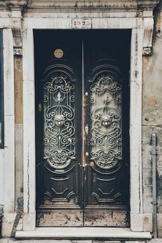 door in venice, italy by dmitri korobtsov