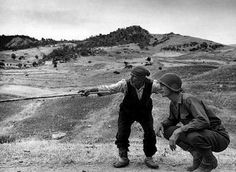 Sicilian farmer showing the way to an American soldier during WWII. Photo by Robert Capa.