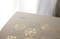 gold foil + letterpress 2013 Prisms Calendar // by Julia Kostreva