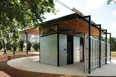 A steel box contains three unisex disabled toilets while the extended roof provides shelter.