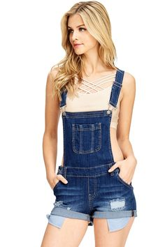 f5b8df58d35b Denim short overalls with a single chest pocket and adjustable straps that  can be worn straight or crossed at the back with front clasp closures.