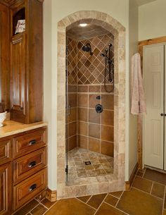 love the corner shower, but one double that size would be amazing | traditional bathroom by USI Design & Remodeling