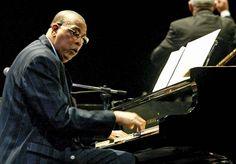 Chucho Valdés, a jazz musician, plays piano with the Cuban orchestra Irakere.