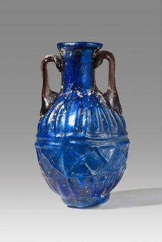 Roman Blue Glass Amphoriskos | Vessels   Date:  1st Century AD Culture:  Roman Category:  Vessels Medium:  Glass