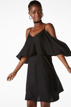 This superb cold shoulder slip dress is on the loose with a ruffle layer. Adjustable straps for fantastic fit.