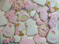 I haven't done traditional baby shower cookies in a while. These were fun. I added a new stork (inspired by a Wilton design), new onesies, a baby dress, and changed up my rattle with beads (inspired by cakecentral decorator (? Galletas Cookies, Milk Cookies, Cute Cookies, Sugar Cookies, Iced Cookies, Baby Girl Cookies, Baby Shower Cookies, Tea Party Baby Shower, Baby Party