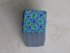 Murrina caleidoscopio verde y azul en arcilla polimérica