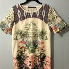 Zara Tropical Shift Dress Lightweight summer shift dress with floral/tropical pattern. Longer than picture shows. Fits larger than expected, I could fit into it comfortably when I was a size 5/6. Zara Dresses Mini