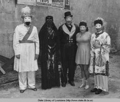People posing in their Mardi Gras costumes in New Orleans Louisiana in the 1940s