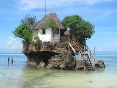 Zanzibar, Tanzania -- The Rock -- is located on the south-east of Zanzibar island on the Michamwi Pingwe peninsula. The restaurant is situated on a rock not far from shore. Patrons can reach the restaurant by foot during low tide and by boat at high tide (offered by the restaurant).