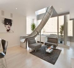 New York Penthouse with a slide! Spiral slide New York penthouse by LEVEL Architects New York Penthouse, Luxury Penthouse, Penthouse Apartment, York Apartment, Manhattan Penthouse, Manhattan Apartment, Apartment Living, Living Rooms, Dream House Interior
