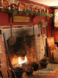 love the fireplace, definitely want a keeping room someday. I absolutely love the dough boards Primitive Fireplace, Primitive Homes, Fireplace Hearth, Primitive Kitchen, Primitive Antiques, Country Primitive, Fireplace Ideas, Primitive Furniture, Mary's Kitchen