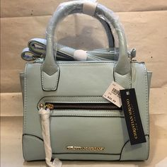 """Christian Siriano Mini Handbag Beautiful Light Blue """"Christian Siriano"""" mini handbag... It is perfect for everyday outfit; matches any color also wear it out at a fancy restaurant. If your looking for a perfect gift for these holidays THIS IS THE PERFECT GIFT! Christian Siriano Bags Mini Bags"""