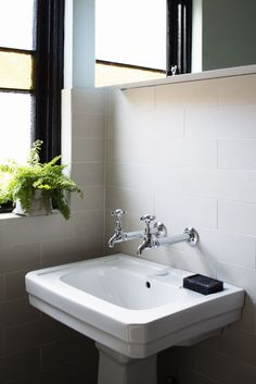 Art Deco basin and extension bib taps in Paddington bathroom by Kate Connors Interiors. Photographed by Craig Wall.