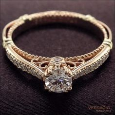 Really love the simplicity but yet has the gorgeous scrollwork on the inside, and has small prong set diamonds along the band! Verragio Engagement Ring