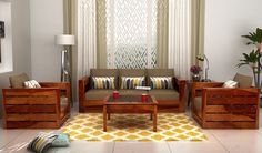 Create a comfortable sitting space for your guests with this sturdy and comfortable sofa set from Woodenstreet. It is made from Sheesham wood and is provided with a classic honey finish. Pair it with a centre table in same finish to create the perfect guest room.  #furniture #livingroom #livingroomdecor #Woodenstreet #India View more on: https://www.woodenstreet.com/wooden-sofa