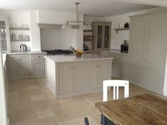 The beautiful Dijon Tumbled Limestone with a mushroom coloured deVOL kitchen. The beautiful Dijon Tu Taupe Kitchen, Green Kitchen, Kitchen Colors, Kitchen Layout, New Kitchen, Kitchen Dining, Devol Kitchens, Home Kitchens, Dream Kitchens