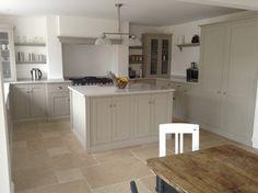 The beautiful Dijon Tumbled Limestone with a mushroom coloured deVOL kitchen.