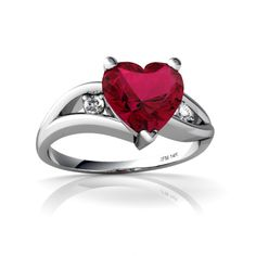 heart shaped ruby ring with two diamonds. I LOVE IT. So pretty and sweet.