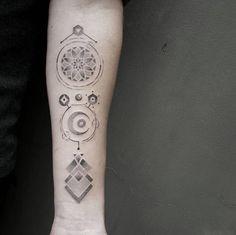 Geometric designs on forearm by Ben Doukakis