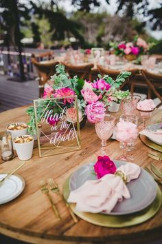 I spy cotton candy in goblets in this pretty in pink reception table / photo: Melissa Biador