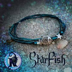 """<b>Thread:</b> Black, Turquoise<b>Colored Glass Beads:</b> Blue, Black, Crystal<b>Star:</b> Tibetan Silver<b>Fish:</b> Tibetan Silver<b>Tag:</b> NTIO (brass)<b>Size:</b> Fits All<b>Close-up Photo:</b> Not Actual Size<b>Starfish:</b> Is part of our new Dark Seas Collection, bringing you deep into the dark, unseen depths of the ocean.Our special """"forever"""" thin chord is color fast and waxed to make it super strong and water resistant. Wear it in the shower or the pool.  The brass tag is hand…"""