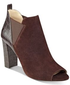 Marc Fisher Sayla Block-Heel Peep-Toe Booties $99.00 Contemporary in a sleek, mixed-media design, Marc Fisher's Sayla booties combine peep toe and block heel styling for a go-to modern look.