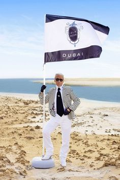 Even Karl is looking a little preppy in his beach attire.