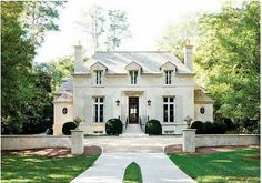 """French Provincial This gem of a house is located in the prestigious Buckhead area of Atlanta. Although titled by the designer as French Provincial, it's a bit more sophisticated than provincial. It is what Calder Loth calls,""""_Petit Noblesse,_ a kind of Pavillion Intime that you would find on a great estate."""" For less than 4,000 square feet, it makes the most of a very narrow lot, hardly wider than the house itself. http://www.classicist.org/awards-and-prizes/shutze-awards/2010-shutze-awards/"""