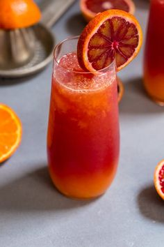 This Winter Tequila Sunrise cocktail will transport you away from the cold and snow. Made with fresh blood orange and tangerine juice, it's a fresh take on a classic cocktail! Prosecco Cocktails, Tequila Drinks, Sweet Cocktails, Winter Cocktails, Classic Cocktails, Cocktail Drinks, Sangria, Alcoholic Beverages, Mixed Drinks With Tequila