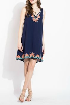 1b2bcdde26f98 This sleeveless dress with embroidered detail trim is elegant enough for  evening paired with heels,