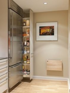 Hidden skinny pantry between fridge and wall