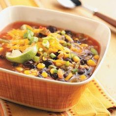 Black Bean Soup:  1 can (15 ounces) black beans, rinsed and drained1-1/2 cups chicken broth3/4 cup chunky salsa1/2 cup canned whole kernel corn, drainedDash hot pepper sauce2 teaspoons lime juice1 cup (4 ounces) shredded cheddar cheese2 tablespoons chopped green onions