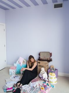 Fasionista Corri McFadden shows us how The Land of Nod is helping her get a nursery ready for the arrival of her baby girl.  See the products every new mom needs! [CLICK FOR FULL FEATURE] nursery // stroller // baby girl // purple // lavender // baby clothes // nursery design // crib // baby checklist // nursery floor plan