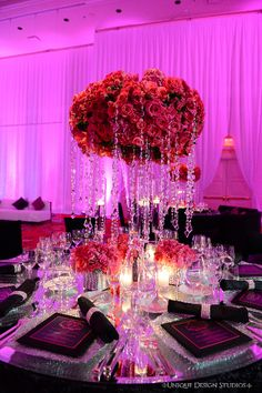 Hot pink roses and cascading crystal centerpieces from our Las Vegas wedding. Destination wedding planning and design by Tiffany Cook Events