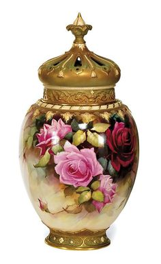 A Royal Worcester large covered pot pourri by William E. Jarman, circa 1910, the cover in the form of a Crown, the body painted with rose leaf and branch, heightened in gilt, puce factory marks and signed W. E. Jarman 45 cm high  Carter's Price Guide to Antiques and Collectables