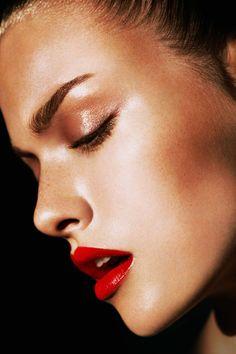 Bronzed eyes & cheek bones with glossy red lips.