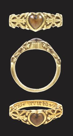 Decorated gold ring with wolf's tooth set in a heart-shaped bezel, made between 1200-1300 in France or England, inscription added around 1375-1425