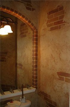 faux cracked plaster over brick