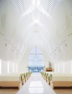 Slate-clad chapel by Eriko Kasahara boasts a veil-inspired ceiling structure. (Height and light and tracery).