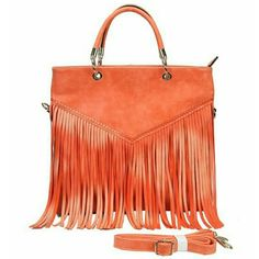 """Indie style orange Celibrity  big fringed handbag Indie style orange color Celibrity  big fringed handbag   Exterior - 15"""" W bottom X 13"""" H X 2.6"""" D, handle-8"""" drop, Shoulder Strap - 28"""" drop   Indie inspired. Long ruffles. One external zipper pocket on the backside. Two internal zippered pockets. One internal accessible small pouch. High quality synthetic pu leather material Bags Totes"""